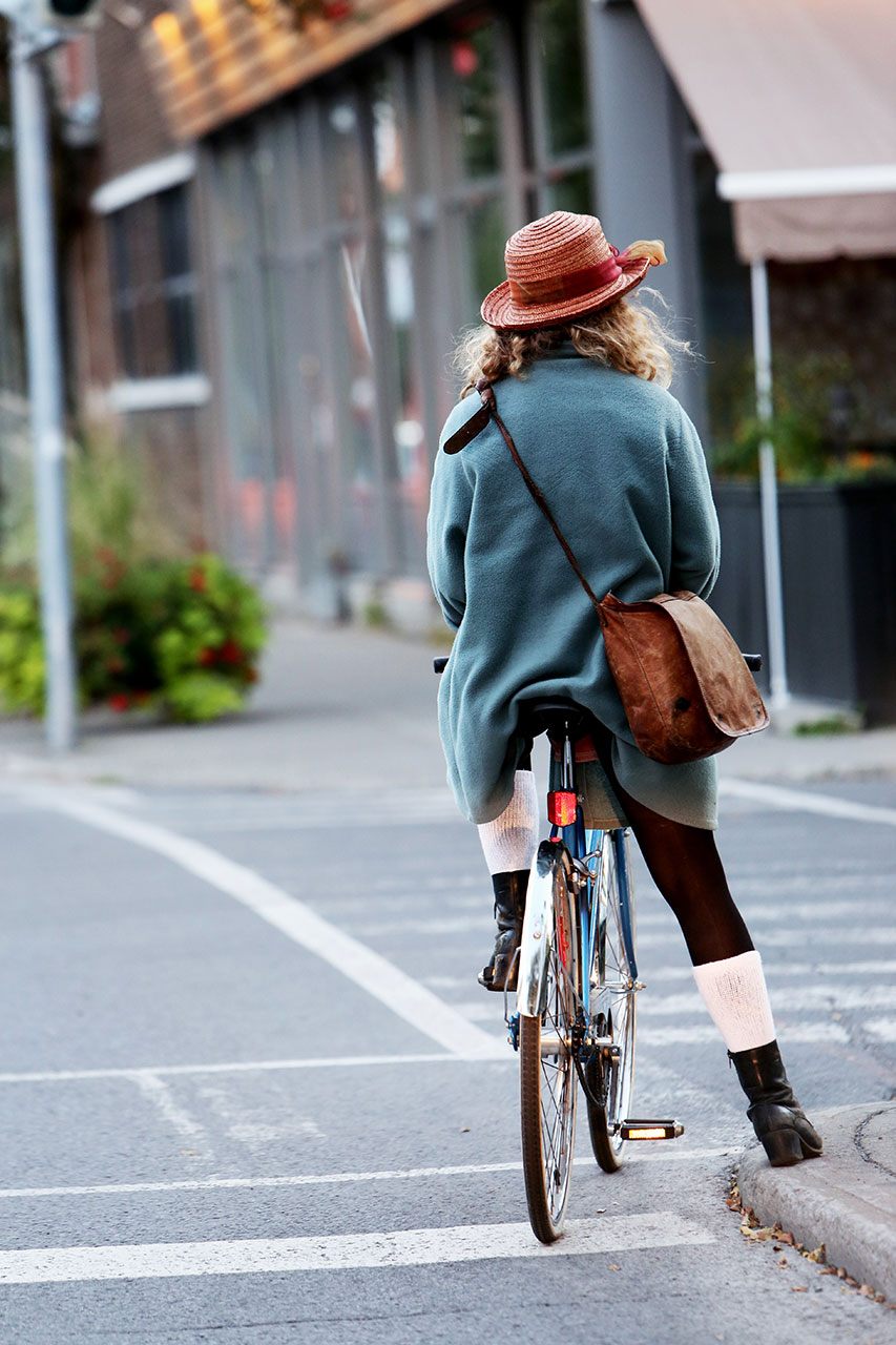 Woman-Riding-Bicycle-Outdoors